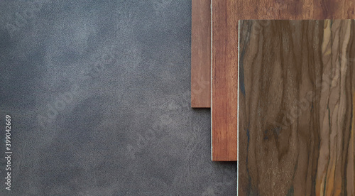 Fototapeta combination of interior material between set of red brown tone wooden veneer containing hickory ,oak ,cherry wood texture placed on dark brown leather fabric (focused on leather texture). obraz na płótnie