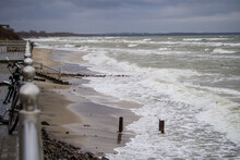 WINTER SEA SHORE WAVES AND HEAVY WINTER CLOUDS