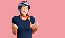 Beautiful Caucasian Woman Wearing Bike Helmet Very Happy And Excited Doing Winner Gesture With Arms Raised, Smiling And Screaming For Success. Celebration Concept.