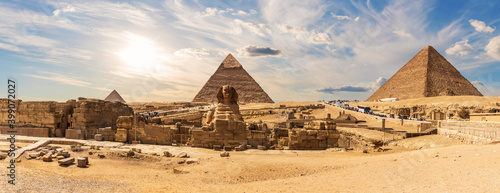 Fototapeta The Great Pyramids of Giza and The Sphinx near the ruins of a temple in Giza, Eg