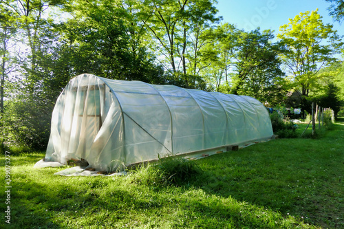 Canvas Print Sheet of polythene laid loosely over a polytunnel construction prior to tighteni