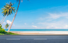Beautiful Beaches Road And Coconut Trees In Thailand.