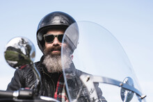 Man In Sidecar With Big Beard And Leather Jacket With Parked Motorcycle