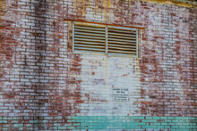 Old Brick Mill Building And Wall Warning Sign Downtown Augusta