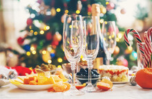 Christmas Table With Champagne And Food. Selective Focus.