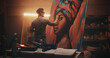 Man creating portrait of black woman