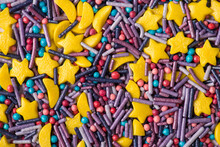 Closeup Top View Photo Of Sugar Sprinkles In Shape Of Star Moon Sticks And Mini Balls In Light Colors