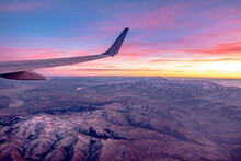 Flying Over Rockies In Airplane From Salt Lake City At Sunset