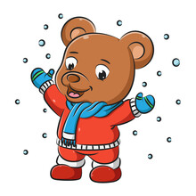 The Brown Bear With The Red Sweater And Scarf Is Playing In The Snow