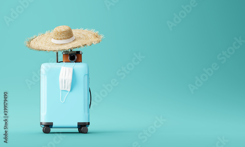 Fototapeta blue suitcase with face mask and travel accessories  on blue background. 3d rendering	  obraz