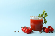 Glass Of Bloody Mary And Tomatoes On Blue Background