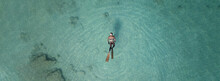 Aerial Drone Top Down Ultra Wide Panoramic Photo Of Spearfishing Scuba Diver In Tropical Exotic Shallow Bay With Turquoise Clear Waters