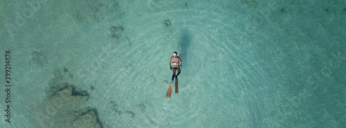 Valokuva Aerial drone top down ultra wide panoramic photo of spearfishing scuba diver in