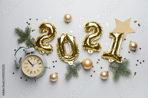 Fototapeta New Year composition with alarm clock and figure 2021 on light background obraz