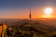 Barcelona, Spain - November 3 2019: Collserola Tower, The Highest Point In Barcelona, Is A Tower Antenna Used Mainly As Tv And Radio Transmitter. Seen Here At Sunset