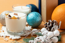 Close-up Of Candles, Orange And A Gift In A Box With A Blue Ribbon, White Wax In A Bowl, Popular Colors, Christmas.