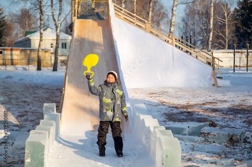 Fotografia, Obraz Little boy riding a mountain on plastic