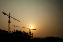 Crane On Construction Site At Sunset.