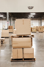 Cardboard Boxes Piled On Pallets In Warehouse.