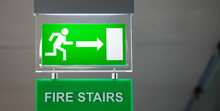 Lit Emergency Exit Sign.