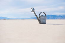 Watering Can On Salt Flat.