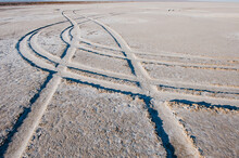 Raised Ridges And Lines, Tyre Tracks On A Desert Surface.
