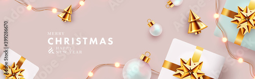 Fototapeta Christmas banner. Xmas background design with realistic gift boxes, golden conical Christmas trees, bauble balls, garland lights. Horizontal christmas poster, greeting card, header for website  obraz