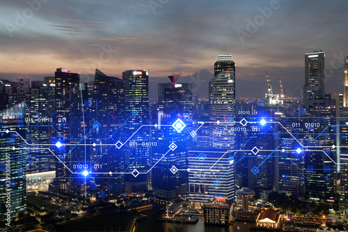 Fototapeta Glowing hologram of technological process, aerial panoramic cityscape of Singapore at sunset. The largest innovative hub of tech services in Asia. Multi exposure. obraz