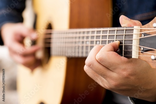 musician playing strum acoustic guitar. Fototapeta