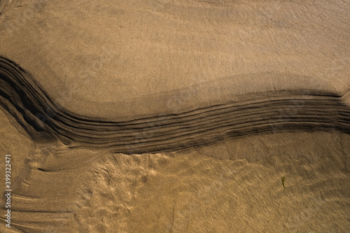 Fotografía Matière de sable doré sur une plage