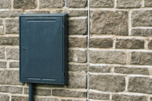 Plastic Box For Electricity And Gas Meters On The Side Of A New House. No People.