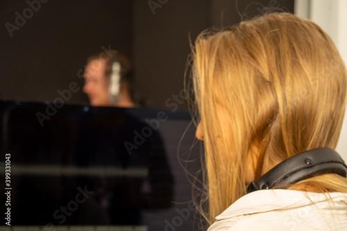 Fotografía Caucasian woman sound composer in recording studio with vocalist singer