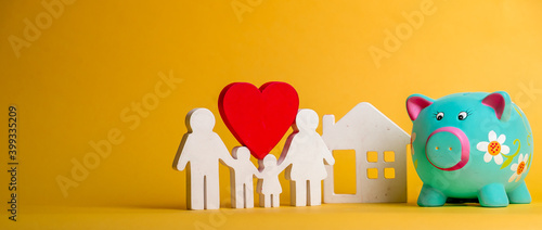 Tela Piggy bank with figures of family and house and red heart