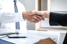 Greeting New Colleagues, Handshake While Job Interviewing, Male Candidate Shaking Hands With Interviewer Or Employer After A Job Interview, Employment And Recruitment Concept