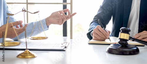 Canvas Print Consultation and conference of professional businesswoman and Male lawyers working and discussion having at law firm in office