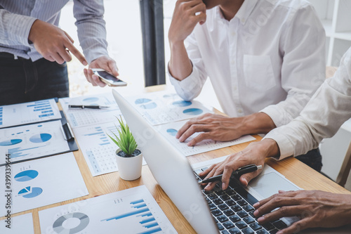 Business casual team manager having a discussion with new project success financial statistics, Partner meeting professional investor working start up project for both company with document