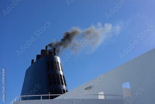 Fotografie, Obraz Ferry ship boat chimney detail with dark black smoke concept of enviromental and