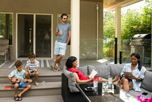 Family Relaxing On Terrace