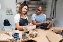 Coworkers Of Ceramics Startup Packing Online Orders