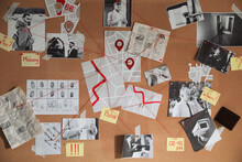 Detective Board With Crime Scene Photos And Red Threads, Closeup