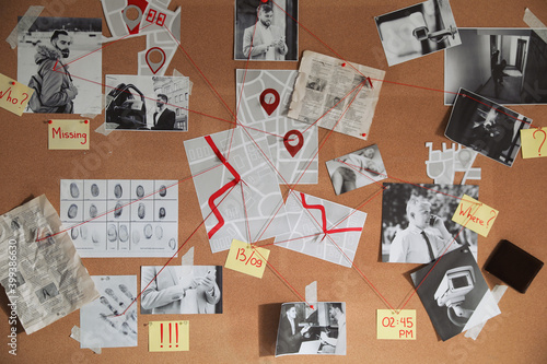 Fotografie, Obraz Detective board with crime scene photos and red threads, closeup