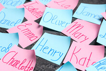 Paper Notes With Different Baby Names On Grey Background