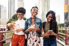 Three Afro Women Using Mobile Phone