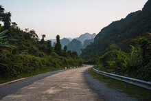 Badly Paved Road Surrounded By Mountains