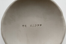 Clay Plate With Inscription Be Happy
