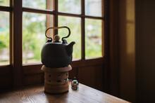 Black Ceramic Kettles On Stove For Making Tea.