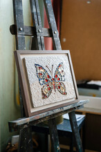 Butterfly Mosaic On Easel In Studio