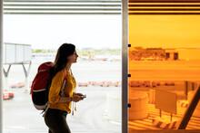 Woman Boarding In The Plane