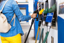 Unrecognizable Woman Holding Fuel Nozzle To Refuel Oil For Car