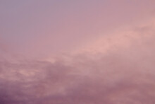 Pink And Purple Storm Clouds At Sunset